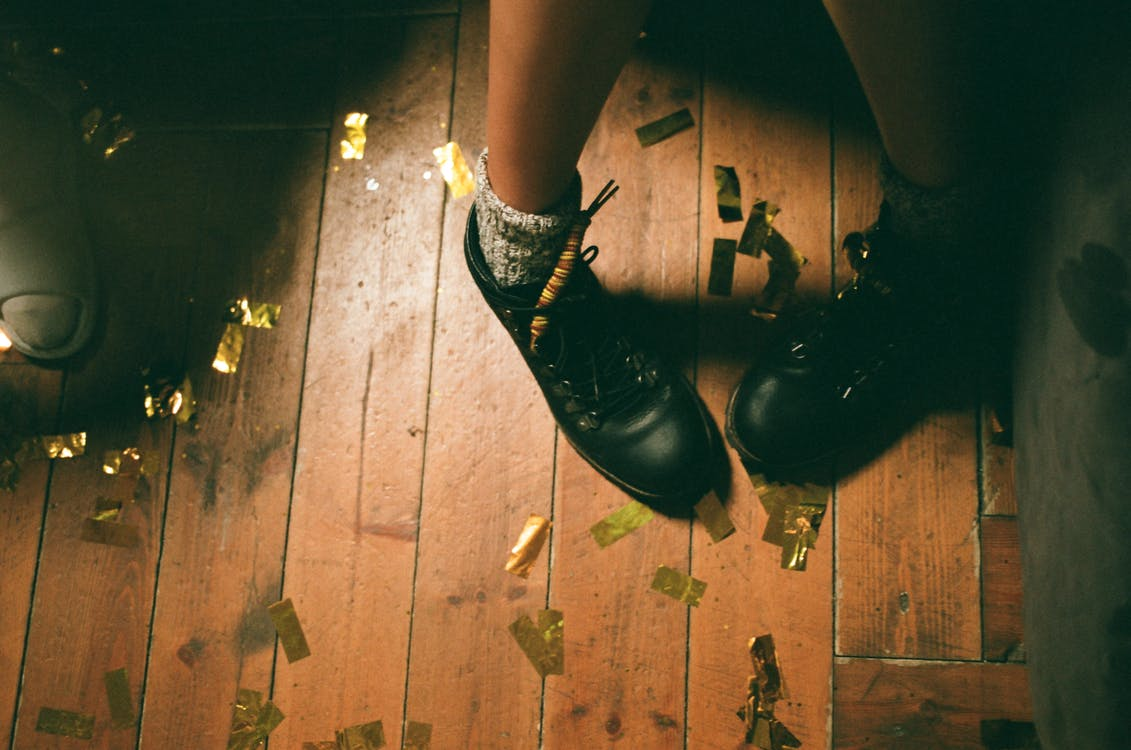 Woman Wearing Black Leather Shoes