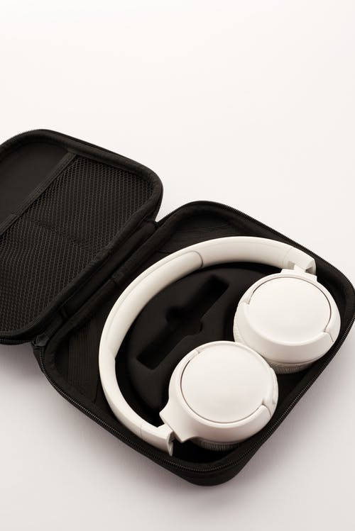 White Wireless Headphones With Black Pouch