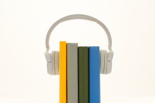 Books Between Headphones