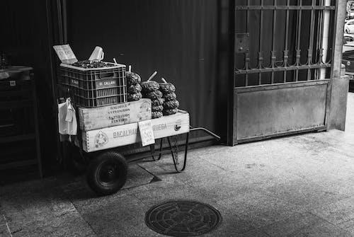 Monochrome Photography of Farm Produce on Cart for Sale