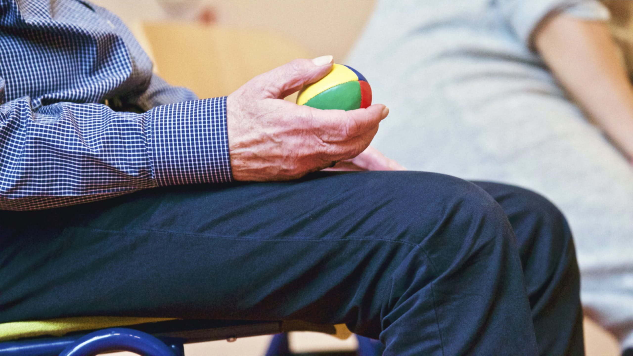 Person Holding Multicolored Ball