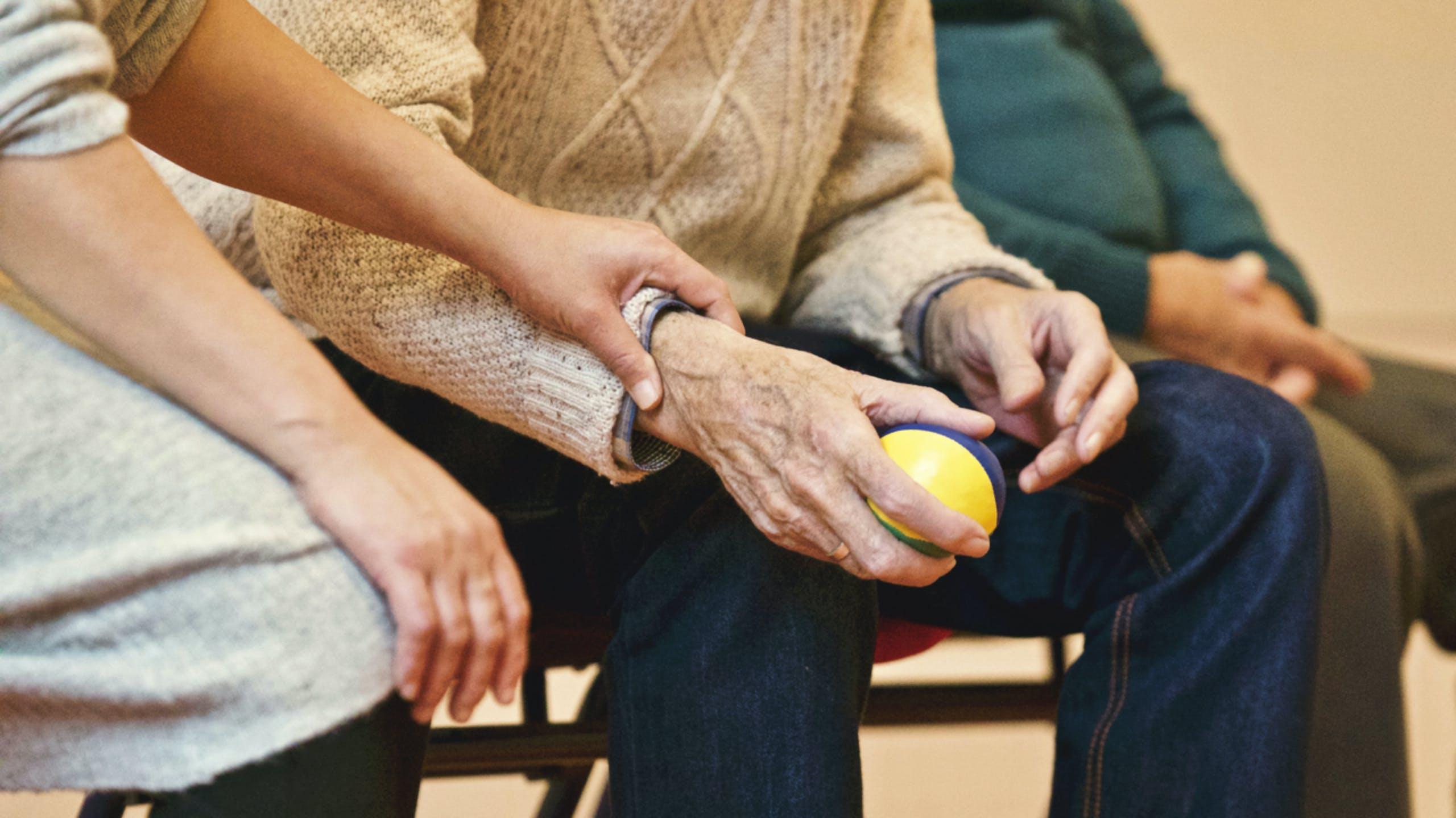 Elderly man gripping ball | PinnacleMensHealthJacksonville.com