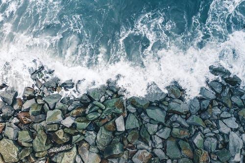 Waves Crashing on Coastal Rocks