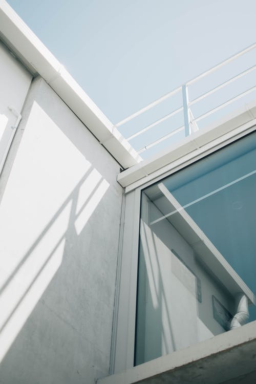 Photo Of A Glass Window On The Exterior Of A White Building
