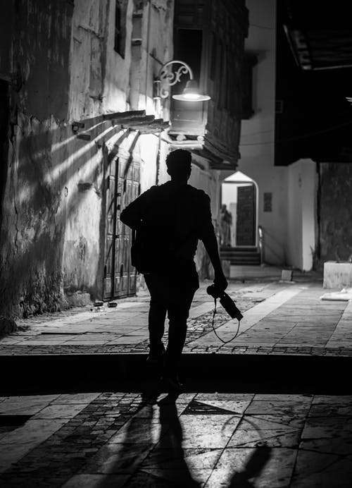 Man Walking on Alley