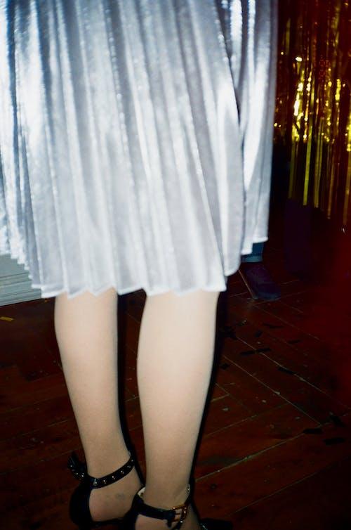 Standing Woman Wearing Gray Dress