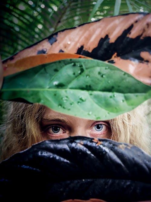 Woman Peeking on Leaves