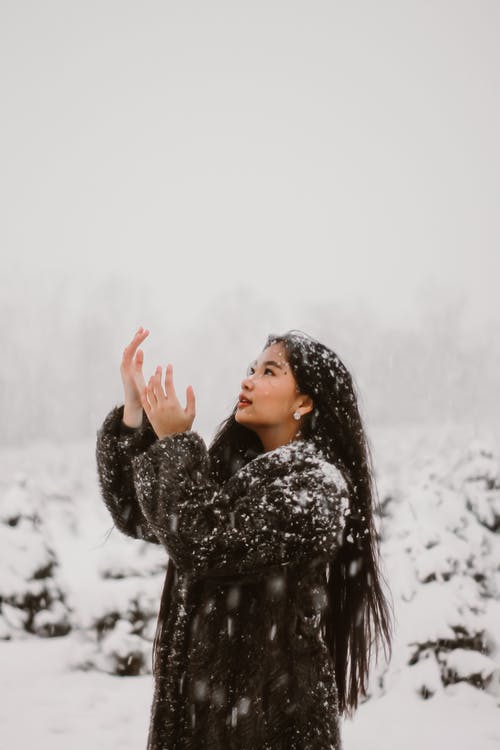 Snow Pouring All over a Woman