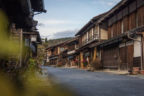 Peaceful Asian village with aged traditional houses