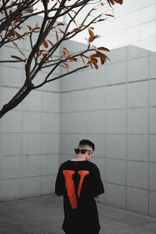 Man in Black Top Standing Outdoors