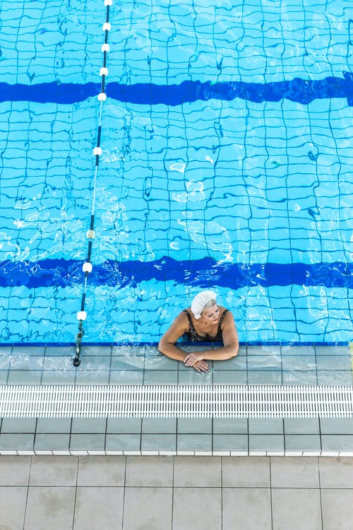Photo Of Woman Submerged On Pool