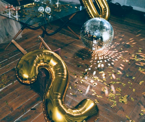 Gold Number Two Balloon and Disco Ball on the Floor