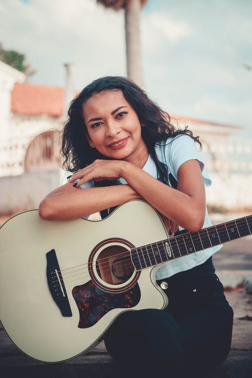 Woman Holding A Acoustic Guitar