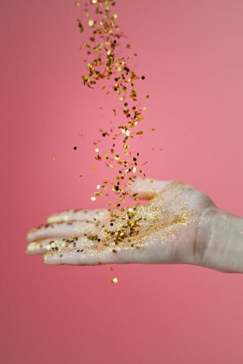 Person Catching Glitters