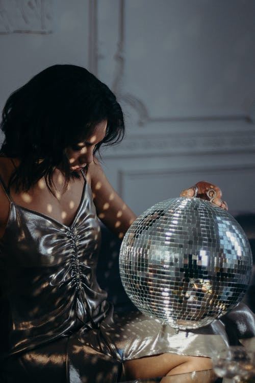 Woman Holding Mirror Ball