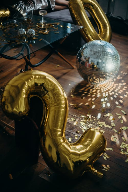 Photo of Disco Ball on Floor Near Numbers
