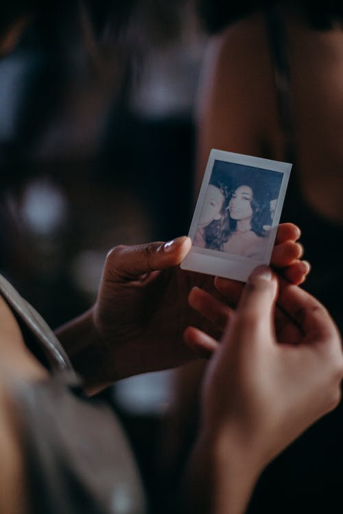 Person Holding Woman's Photo