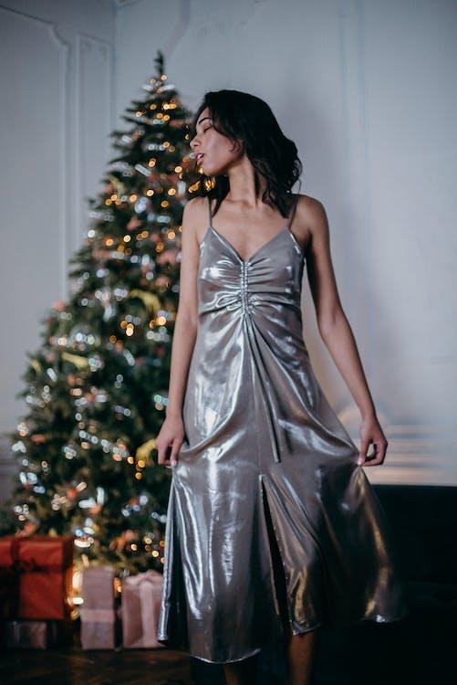 Woman Wearing Silver Sleeveless Dress