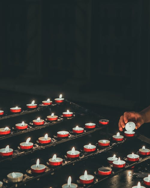 Shallow Focus Photo of Lighted Votive Candles