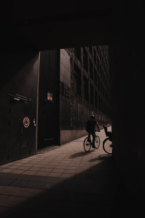 Man on Bike Near Building