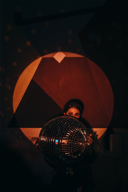 Woman Holding Mirror Ball