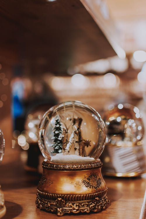Beautiful vintage snow globe in Christmas market