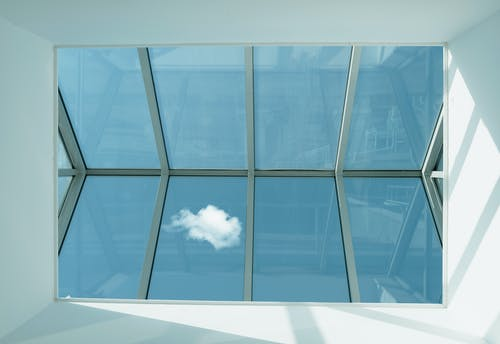 Low-angle Photography of Clear Glass Roof