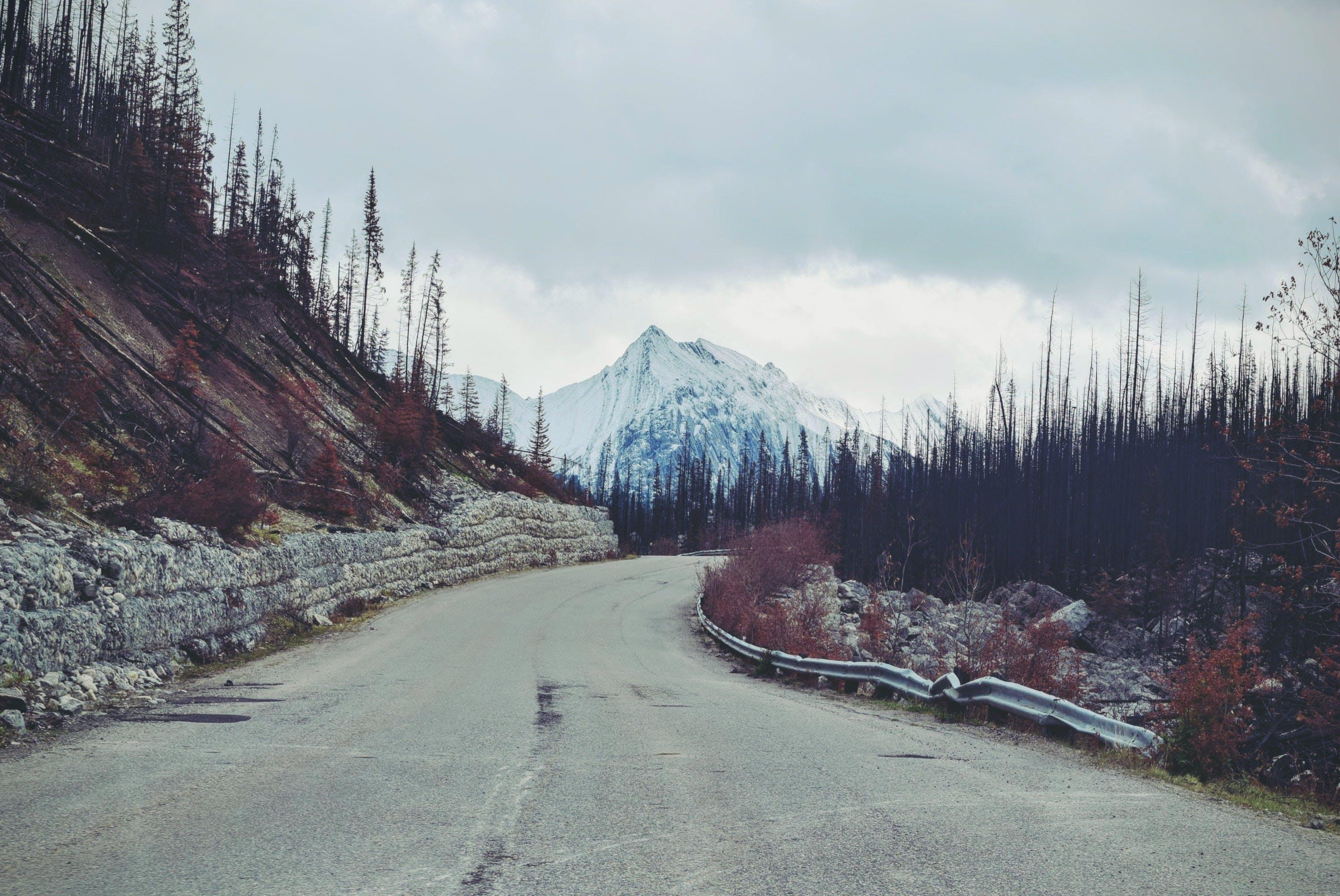 Empty Pave Road Towards Snow Mountain