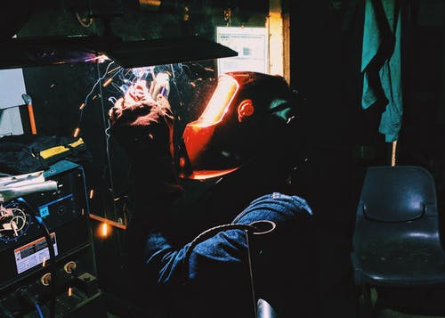 Person Using Torch Welding