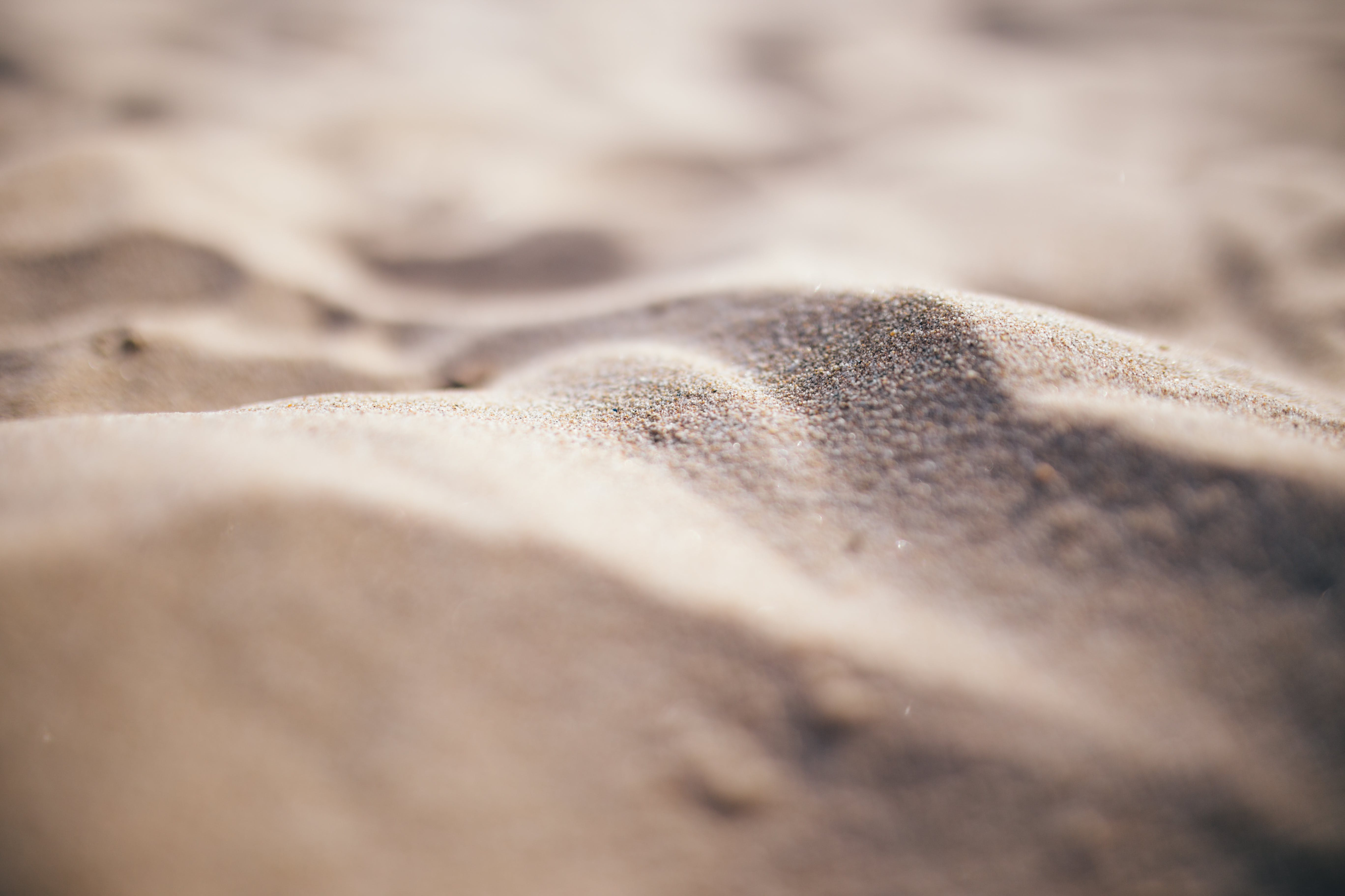 Shallow Focus Photo of Gray Sand