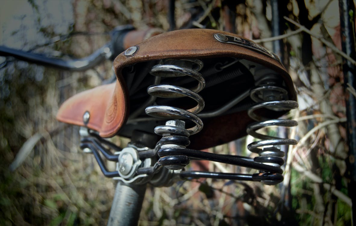 Shallow Focus Photography of Brown Bicycle Seat