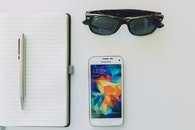 sunglasses, smartphone, desk