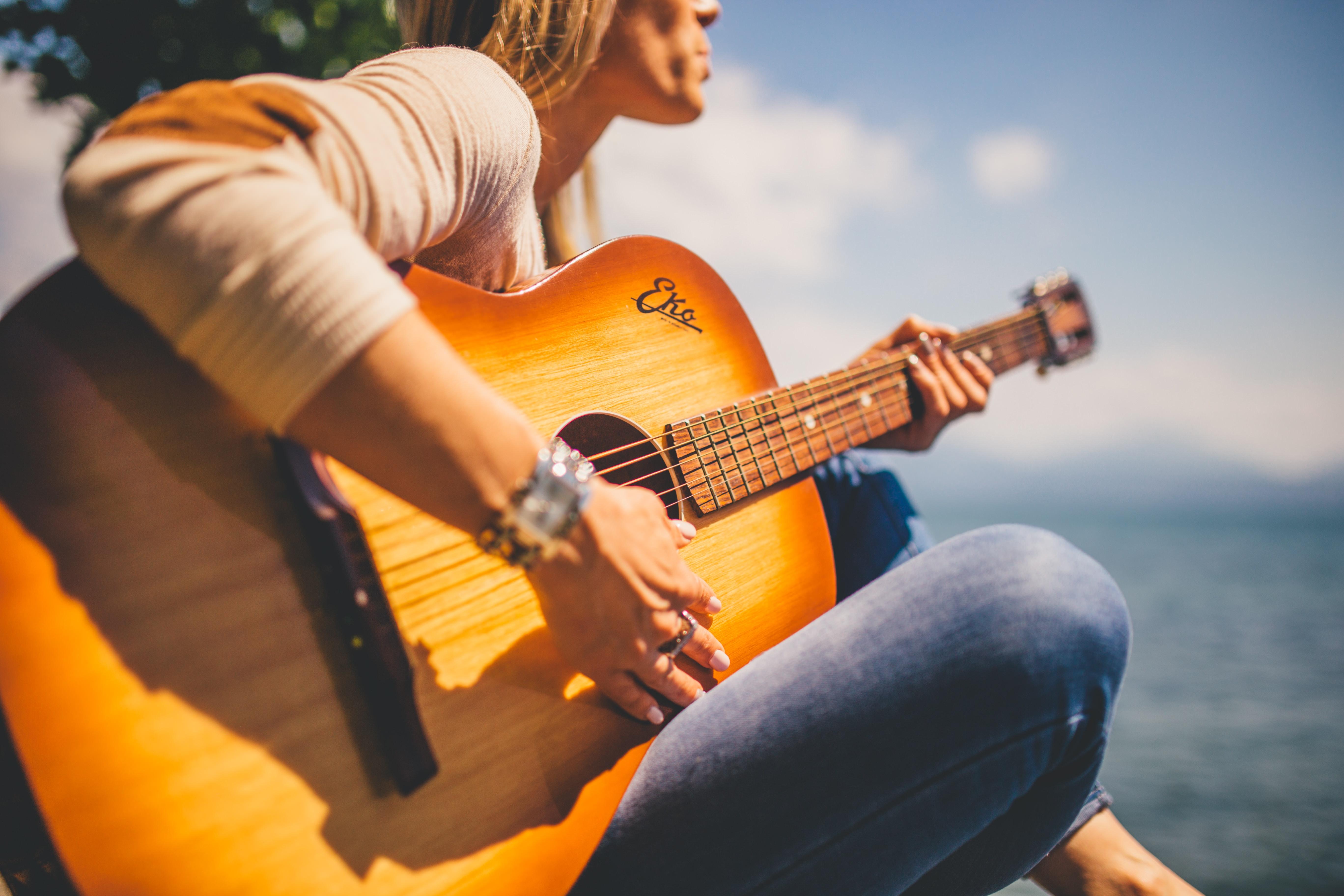 woman sitting holding guitar  u00b7 free stock photo
