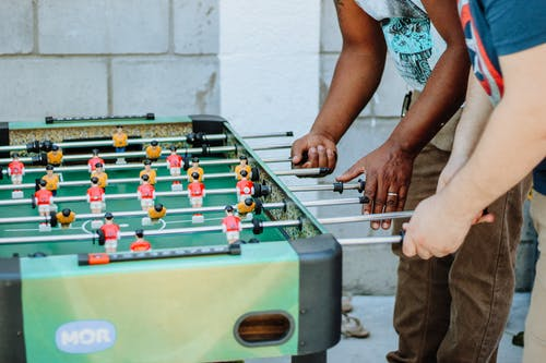Two People Playing Table Football