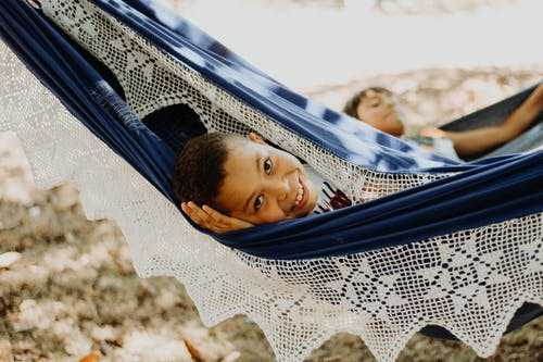 Photo Of Boy Laying On Hammock