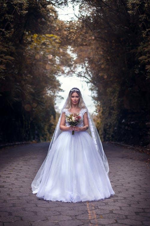 Photo Of Woman Wearing White Wedding Dress