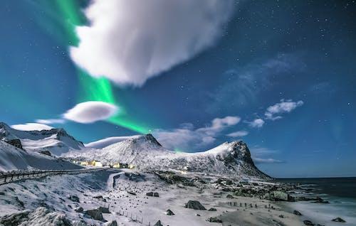 Kostnadsfri bild av aurora, aurora borealis, bergen, bergskedja