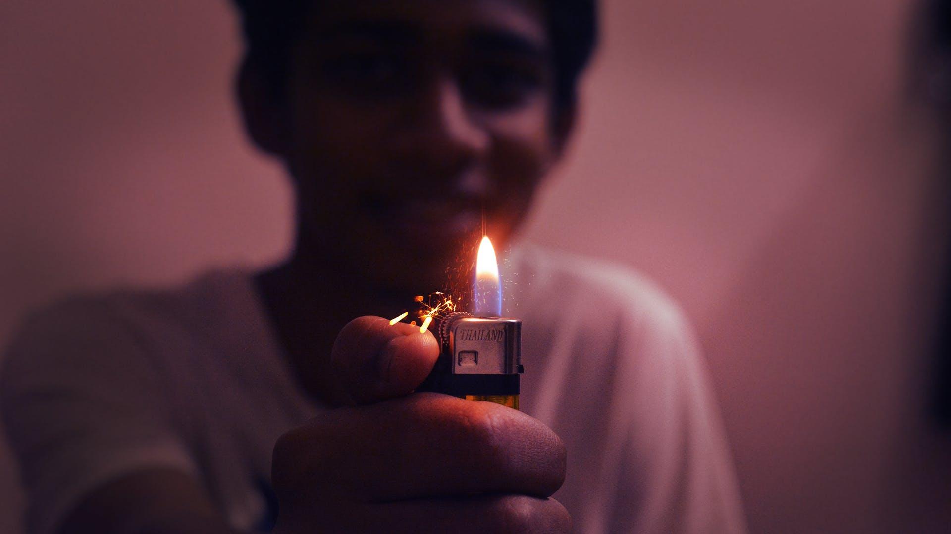 Man Holding Disposable Lighter