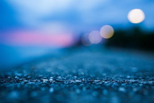 Shallow Focus Photography of Gray Asphalt Floor