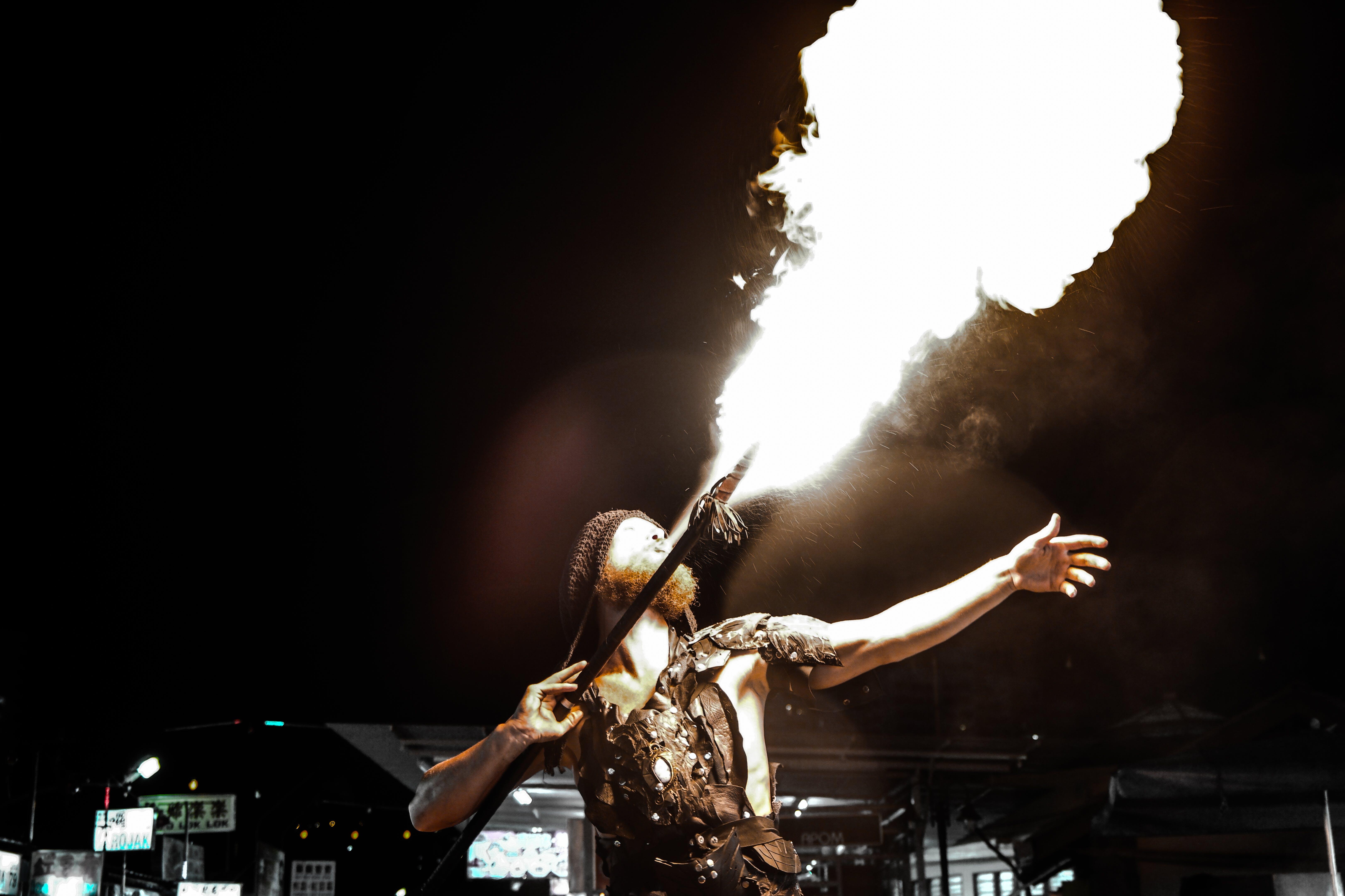 Man Spitting Fire at Nighttime