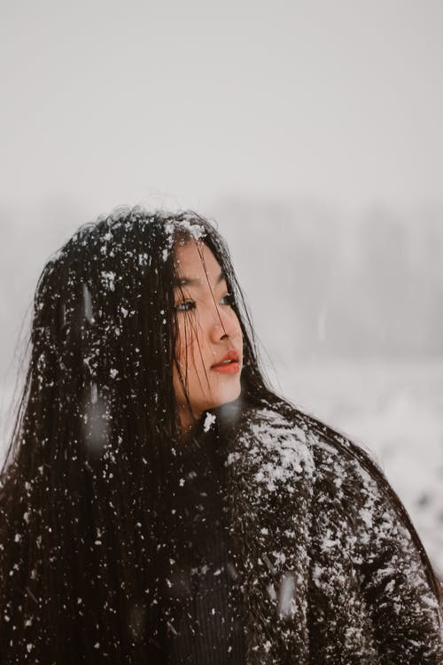 Woman With Snow on Her Clothes