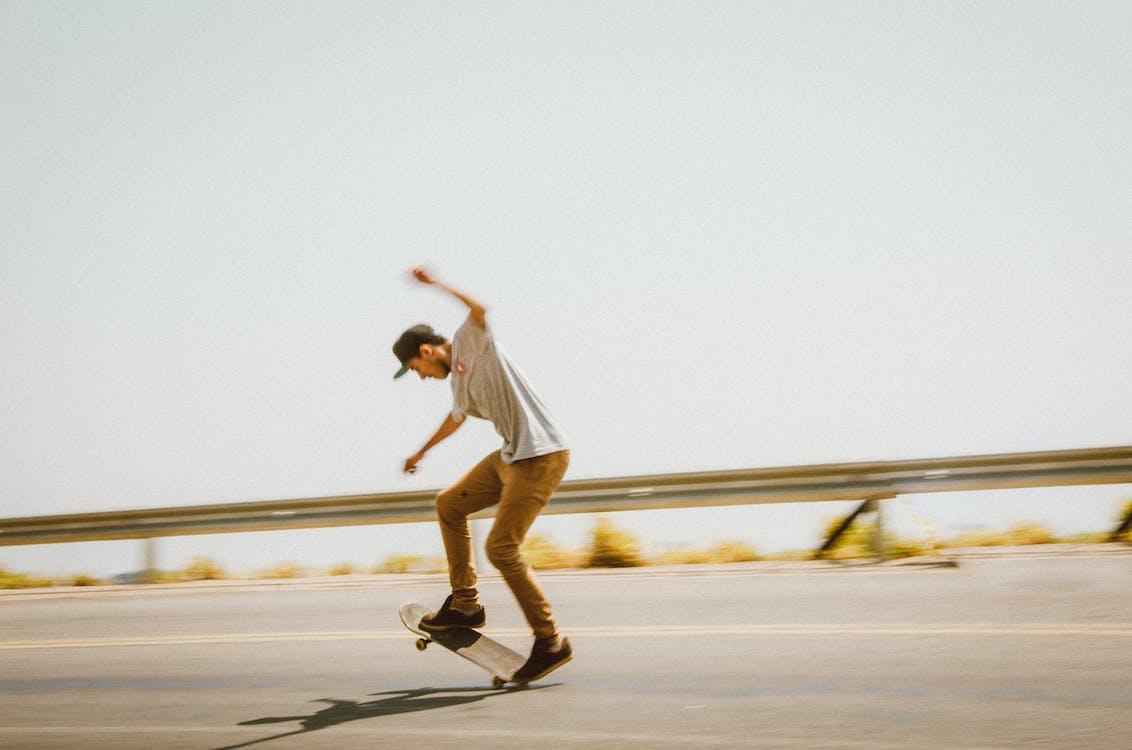 Man Doing Tricks on the Skateboard