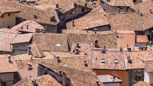 Gratis stockfoto met daken, gebouwen, huizen, woningen