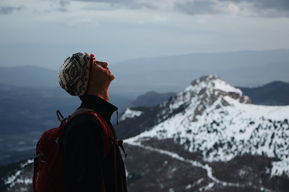 Man Standing on Snow-capped Mountain
