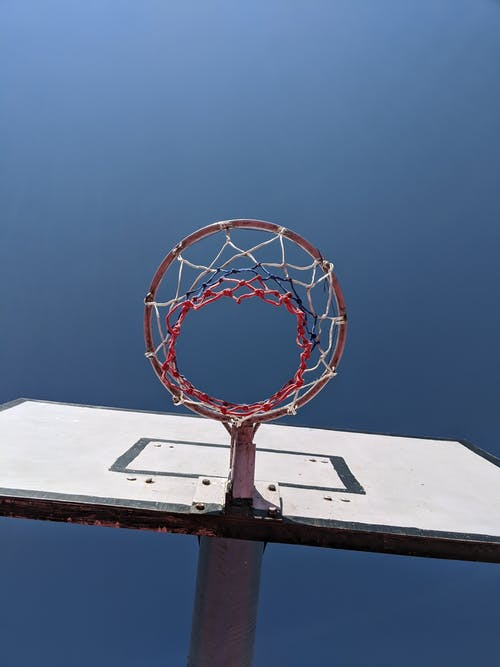 White Basketball Hoop Under Blue Sky