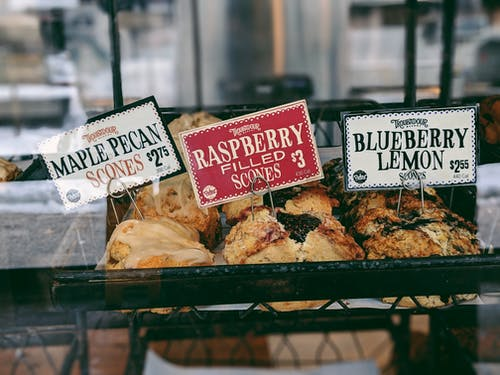 Raspberry Filled Scones at 3 Dollar, Blueberry Lemon Scones at 2.65 Dollar, and Maple Pecan Scones at 2.75 Dollar