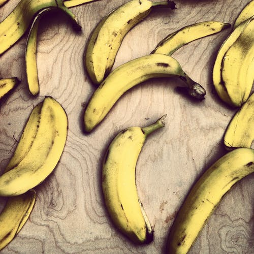 Yellow Bananas on Brown Wood