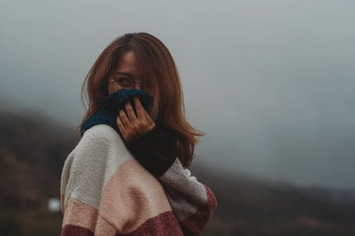 Woman Covering Face With Blue Scarf