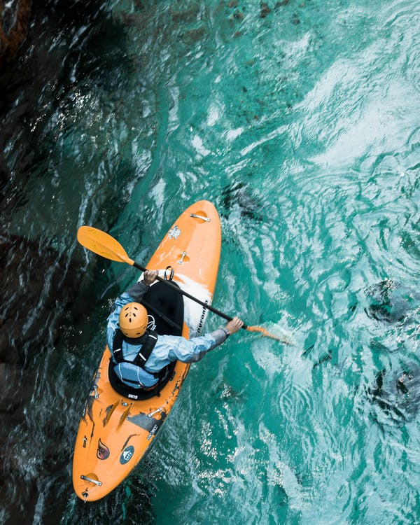 Photo Of Person Riding Kayak
