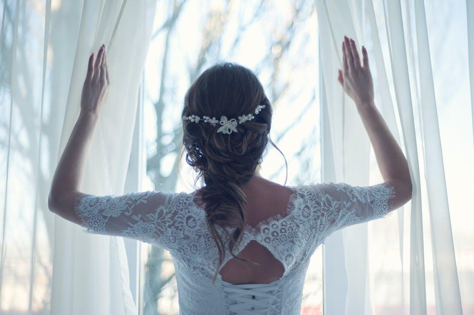Woman Spreading White Textile